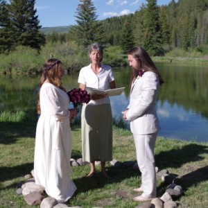 A photo of Carolyn Ringo performing a wedding ceremony outdoors.