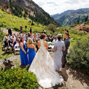 A photo of a wedding ceremony with a backdrop of beautiful Colorado mountains.