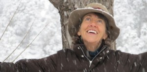 A photo of Ordained Minister, Carolyn Ringo celebrating in the snow.